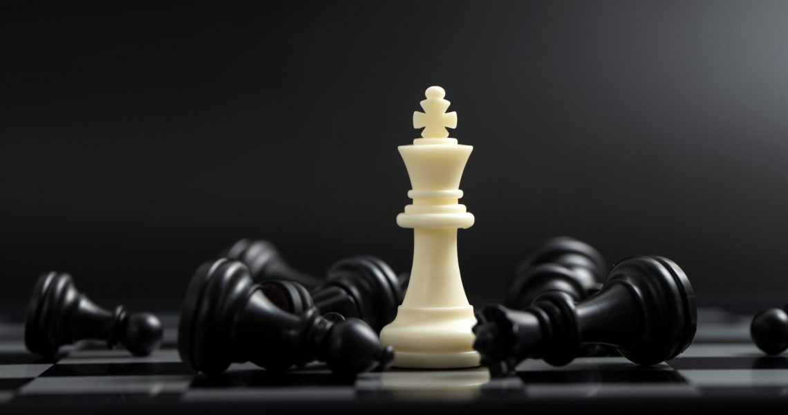 Last standing white king in chess game for business or competition win concept