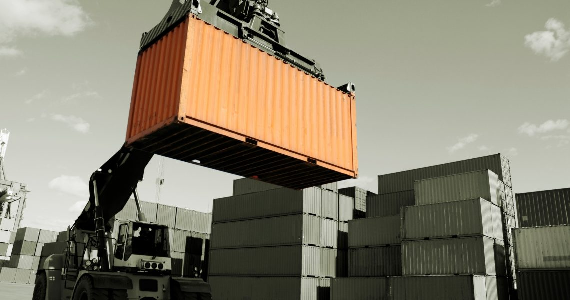forklift stacking containers in port