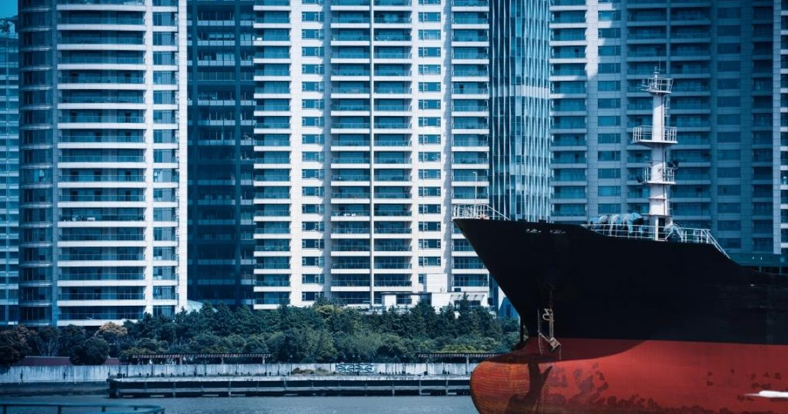 abstract cityscape of cargo ship with modern buildings